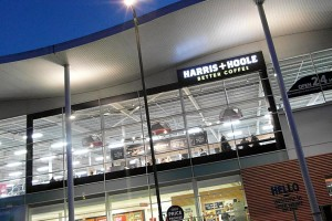 Harris + Hoole: external illuminated sign at night