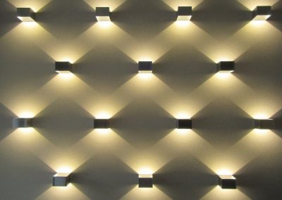 Photo:lights create an interesting pattern on wall