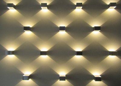 Photo:lights create an interesting pattern on wall