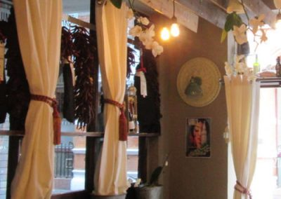 Photo: Window dressed with cured hams