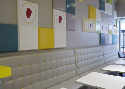Photo: fixed seating tables and boxed wall feature