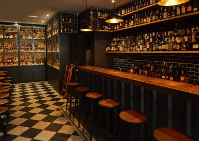 Photo of bar and Whisky cages